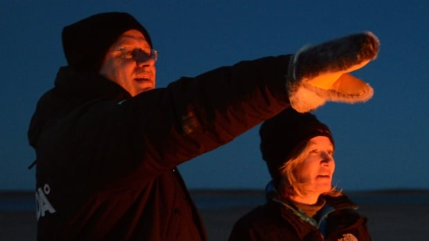 Prime Minister Stephen Harper and wife Laureen at a bonfire at a Canadian Rangers camp near Gjoa Haven, Nunavut, during his 2013 tour of the Canadian North.