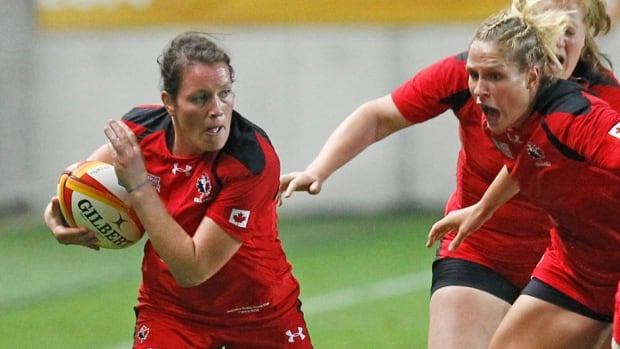 Jacey Murphy, left, and her Canadian teammates will have to match England's physical play if they want to compete in Sunday's final of the women's rugby World Cup in Paris, says Canada's coach Francois Ratier. The Canadians qualified with a 18-16 victory over France.
