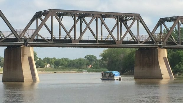 The search for a man who appeared to be in distress in the Red River Friday afternoon continued Saturday, seen here near the rail bridge by the ballpark.