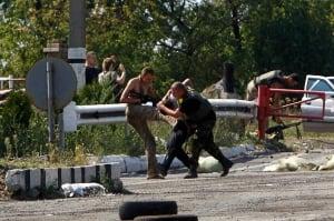 Ukraine crisis servicemen kick Russian activist