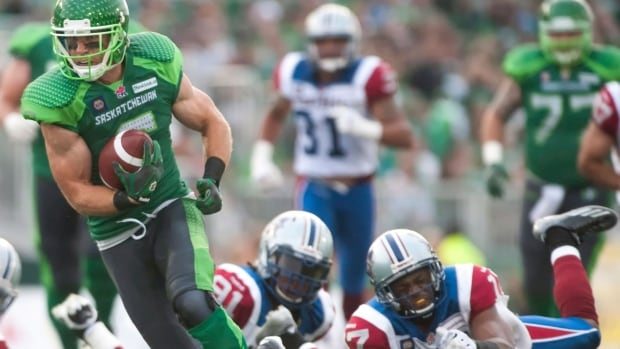 Saskatchewan Roughriders wide receiver Rob Bagg breaks a couple tackles to score the winning touchdown Saturday in Regina.