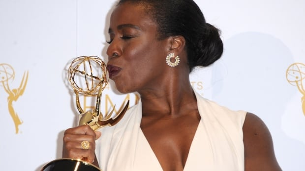Uzo Aduba poses in the press room with the award for outstanding guest actress in a comedy series for Orange Is the New Black at the 2014 Creative Arts Emmys at Nokia Theatre Saturday in Los Angeles.