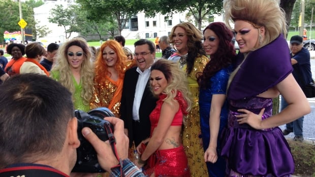 Denis Coderre poses for a photo with a group of lovely ladies at this year's Montreal Pride parade.