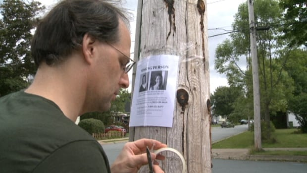 Volunteers put posters up in Catie Miller's neighbourhood in Dartmouth. She's been missing for a month.