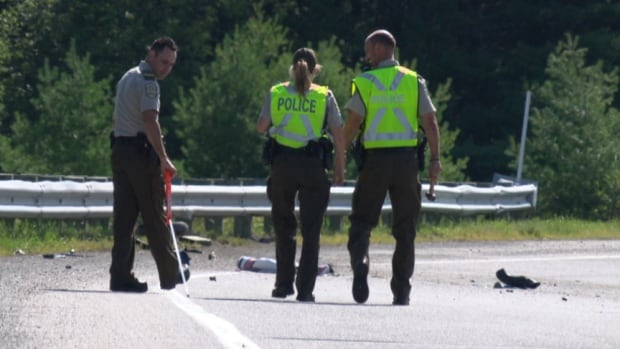 Investigators analyze the scene of a fatal motorcycle crash on a Highway 50 exit lane on Monday morning.