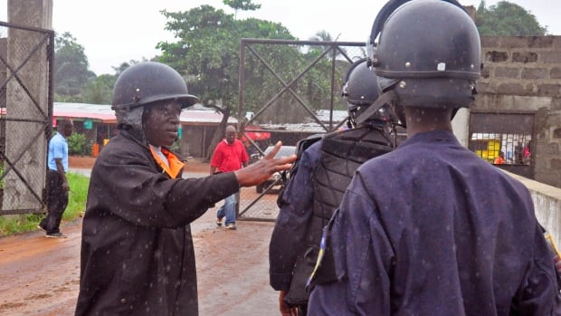 Liberian police deploy at an Ebola treatment centre to provide security in the city of Monrovia, Liberia on Monday. Liberia's armed forces were given orders to shoot people trying to illegally cross the border from neighbouring Sierra Leone, which was closed to stem the spread of Ebola, local newspaper Daily Observer reported.