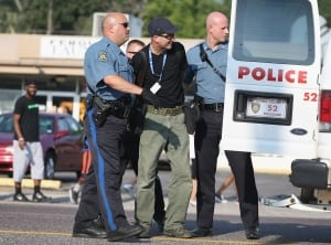 Getty photojournalist Scott Olson arrested in Ferguson, Missouri
