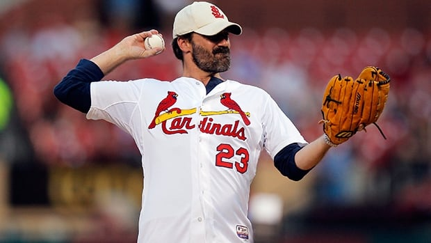 Mad Men star Jon Hamm, from St. Louis, throws the ceremonial first pitch prior to the Reds-Cardinals game on Monday night.