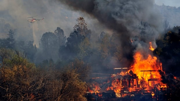 One of several wildfires burning across California prompted the evacuation of hundreds of people in a central California foothill community near Yosemite National Park, authorities said.