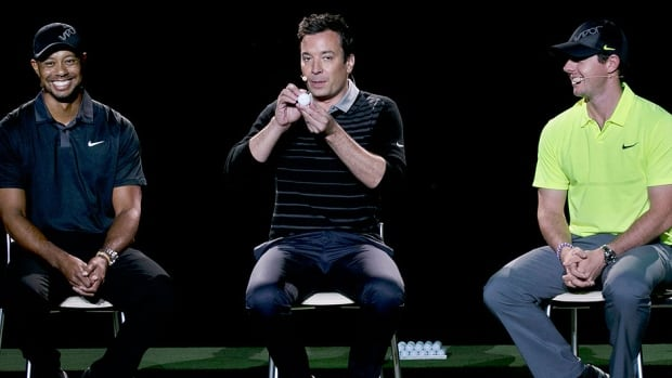 Golfers Tiger Woods, left, and Rory McIlroy right, sit near as television host Jimmy Fallon makes a joke during a golfing demonstration on Monday in Jersey City, N.J.