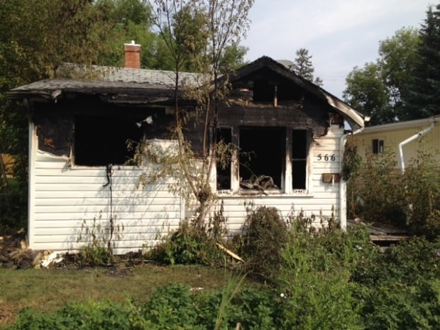 Prince Albert police investigating body found at burned house