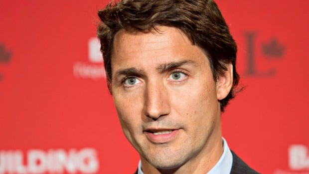 Liberal Leader Justin Trudeau speaks to media during a break at the federal Liberal summer caucus meeting in Edmonton on Tuesday, Aug. 19, 2014.