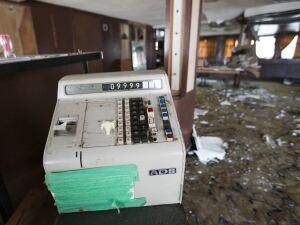Old cash register on Captain John's Harbour Boat Restaurant