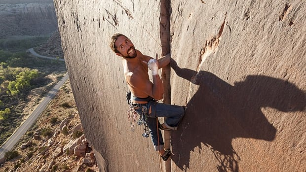 "In this May 2013 photo provided by Jerry Dodrill, Brad Parker is shown climbing ""Super Crack,"" a rock climb at Indian Creek, near Moab, Utah."
