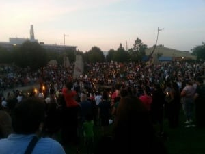 Mourners hold candles at Oodena Circle at The Forks in Winnipeg, mourning the deaths of 15-year-old Tina Fontaine and Faron Hall. Fontaine was killed, put in a bag and dumped in the Red River, according to police. Her body was discovered near the Alexander Docks on Sunday.