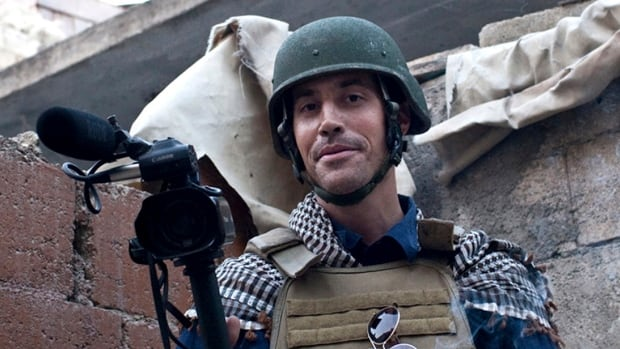 In this November 2012, file photo, posted on the website freejamesfoley.org, American journalist James Foley is shown covering the civil war in Aleppo, Syria. In an act of revenge for U.S. airstrikes in northern Iraq, militants with the Islamic State extremist group beheaded Foley and are threatening to kill another hostage.