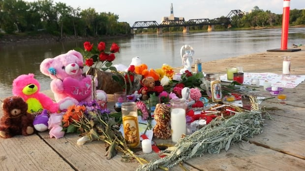 A number of candles were still burning at a makeshift memorial at the Alexander Docks on the Red River Wednesday morning following Tuesday night's vigil for Tina Fontaine and Faron Hall.