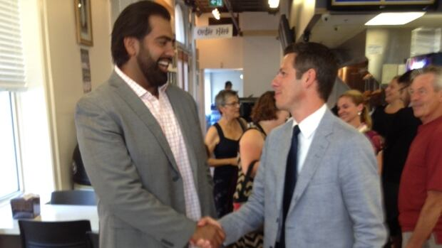 Brian Bowman shakes supporter and former bomber Obby Khan's hand at a campaign announcement on Wednesday.