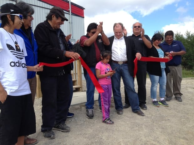 LaSandra Munroe, 6, cuts the ribbon at the new remote training centre in Neskantaga First Nation.