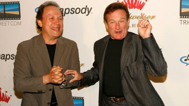 Actors Billy Crystal, left, and Robin Williams are seen during an event in 2006.