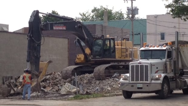 "After a lengthy battle, the city tore down the Minto Apartments, a building known as the ""snake pit."""