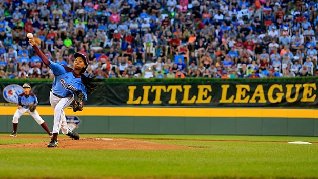 Mo'ne Davis, left, delivers a pitch in the Little League World Series at Lamade Stadium in Williamsport, Penn., on Wednesday.
