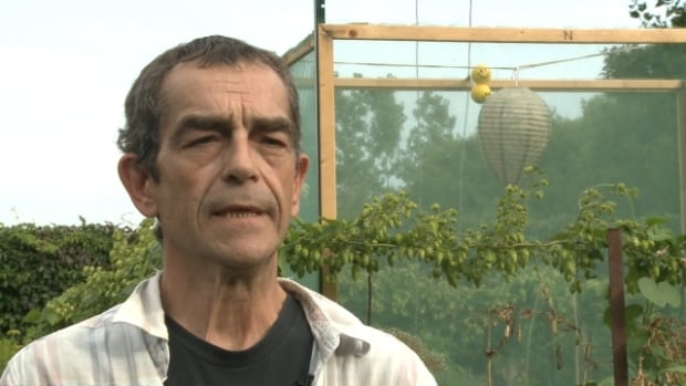 Trowell has received a first warning to dismantle his beehive. If he doesn't do so after a second warning, he could face eviction from the community garden.