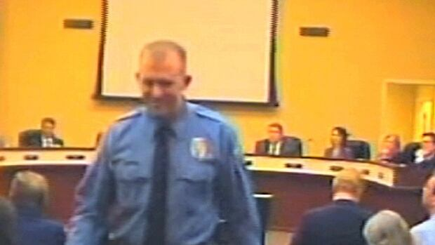 In this  Feb. 11, 2014 image from video released by the City of Ferguson, Mo., officer Darren Wilson attends a city council meeting in Ferguson. Supporters are starting to speak up in his defence.