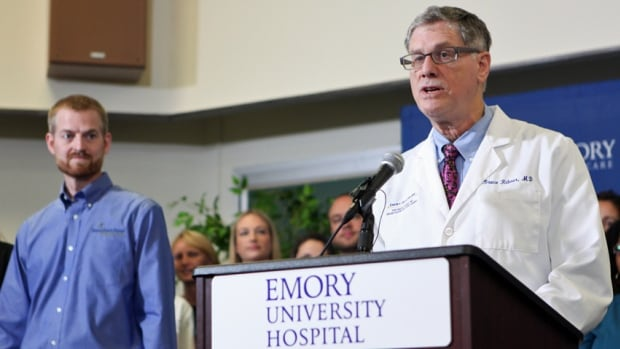Dr. Bruce Ribner, right, announces the discharge of Ebola patient, Dr. Kent Brantly, during a press conference on Thursday in Atlanta.