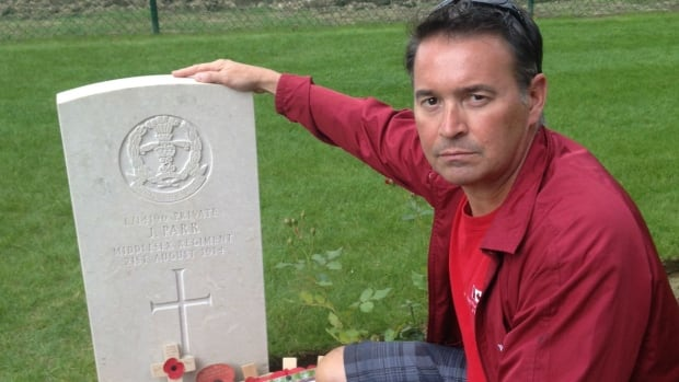 John Hetherington, a history teacher from North Bay, beside the grave of Private John Parr the first British soldier to be killed in action during the Great  War August 21st 1914.