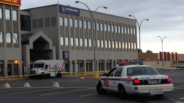 Police are reviewing security cameras at the scene of the Brossard, Que., armoured car heist that resulted in the theft of about $400,000.