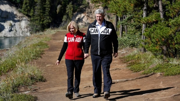 Prime Minister Stephen Harper and his wife Laureen tour Miles Canyon near Whitehorse, Yukon on Thursday, the first day of his annual tour of Northern Canada. This year, China's official news agency and the Communist Party newspaper will not be present.