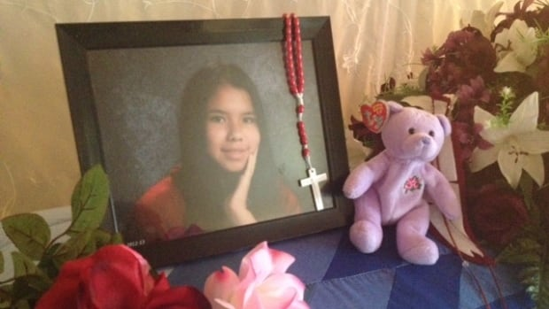 A photo of slain teen Tina Fontaine sits atop her casket in a family home on Sagkeeng First Nation last summer.