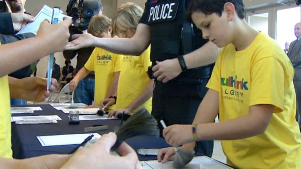 Children participating in a summer camp got to check out how to fingerprint at the new YouthLink centre, which is set to open in 2015. The centre is under construction, so the summer camp is being held at police headquarters nearby.