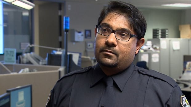 Emergency communications officer Ayuz Mukadam says people calling 911 are relieved when they hear someone who speaks their language.