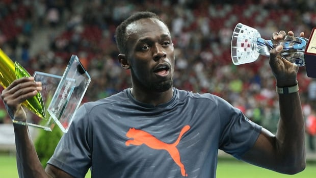 Usain Bolt, showing off his hardware from winning Saturday's 100-metre race in Poland,  made it his final competition of the season. He participated in only three races because of injuries.