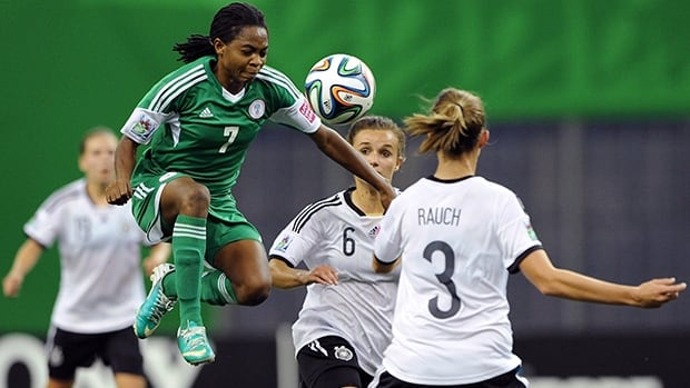 Loveth Ayila (7) of Nigeria leaps for the ball in the FIFA U-20 Women's World Cup final at Montreal's Olympic Stadium on Sunday.