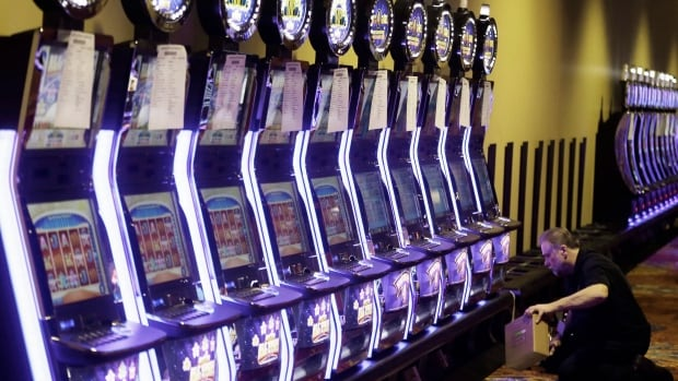 A worker sets up a video lottery terminal. The My-Play System was first introduced by the Nova Scotia Gaming Corporation in 2010 to prevent non-problem gamblers from becoming addicted to video lottery terminals.