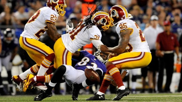 Washington safety Brandon Meriweather (31) was suspended two games for a hit on Ravens receiver Torrey Smith (82) during Saturday night's pre-season game.