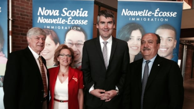 Colin Dodds (far left) and Wadih Fares (far right) are the co-chairs of the newly-created Premier's Immigration Advisory Council.