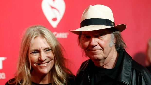 Musician Neil Young and wife Pegi Young are seen at a 2012 MusiCares event in Los Angeles.