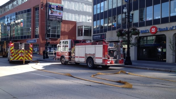 Winnipeg fire crews deal with reports of a gas leak at a building on Portage Avenue near Carlton Street on Wednesday morning.