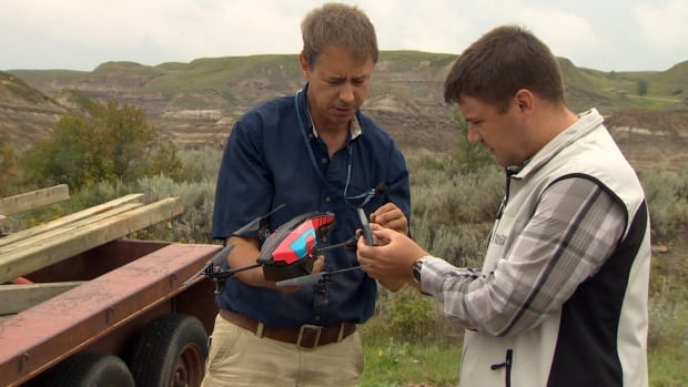 Paleontologists from the Royal Tyrrell Museum are using drones to fly over the famous dinosaur fossil beds in the badlands near Drumheller, Alta.