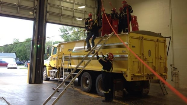Members of the Winkler Fire Department trained on Monday with the barrel-shaped rescue tube, designed to aid in rescuing people trapped in grain bins.