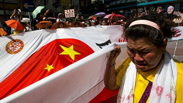 Thousands of pro-Beijing protesters, some of them reportedly bused in, carried Chinese national flags and took part in a counter-march, on Aug. 17, to the huge pro-democracy Occupy Central demonstrations in July.