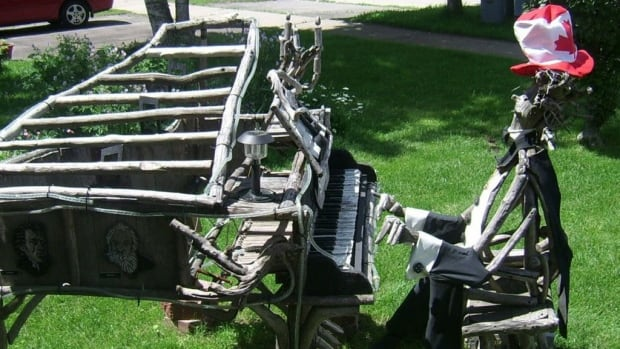 Donna Mak's driftwood pianist was taken from her front lawn on Aug. 26.