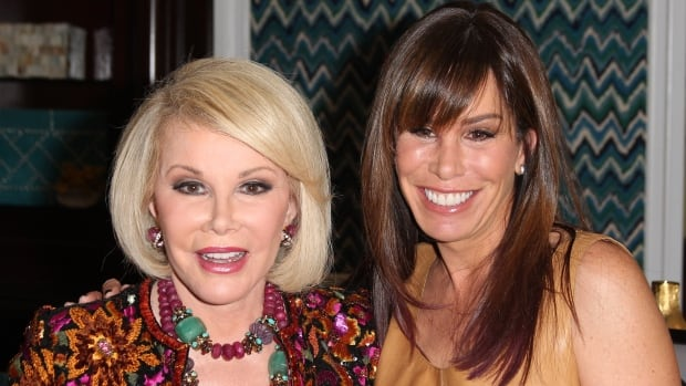TV personalities Joan Rivers and her daughter, Melissa Rivers. In a statement Thursday, Melissa said her mother was 'resting comfortably'.