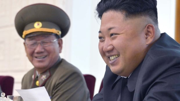 A senior banking official who managed money for North Korean leader Kim Jong-un, right, is believed to have defected in Russia and is seeking asylum in a third country.