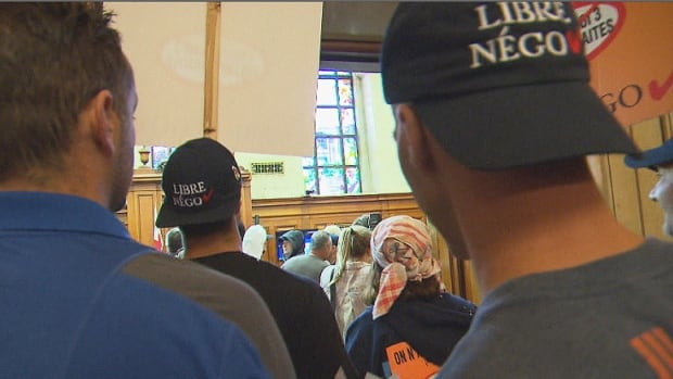 Municipal workers stormed into Montreal City Hall council chambers during a protest against Bill 3 on Aug. 18.