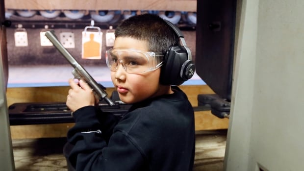 Andrew Josequera, 11, prepares to shoot at a target at a gun club in Los Angeles. A deadly accident at an Arizona gun range this week, where a nine-year-old shot her instructor while firing an automatic firearm, has raised questions about children and gun ranges.